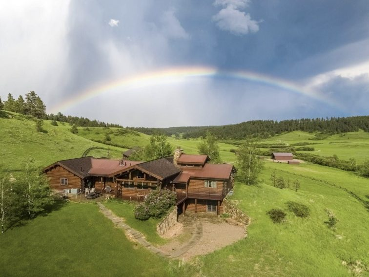 Aerial view of Horsethief Basin Ranch with rainbow.