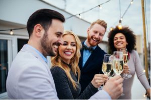 luxury real estate agents toasting to each other