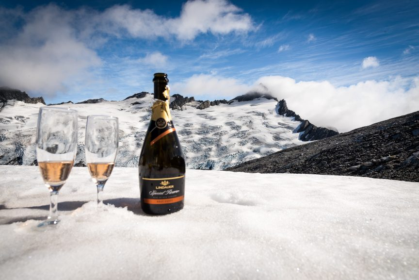 Certified Luxury Home Marketing Specialist's champagne on a snow covered mountain