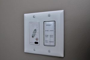An outlet that controls the lights of the room, kitchen, lamps, and the brightness