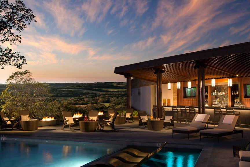 luxury home with pool and open air bar overlooking the hills and sunset