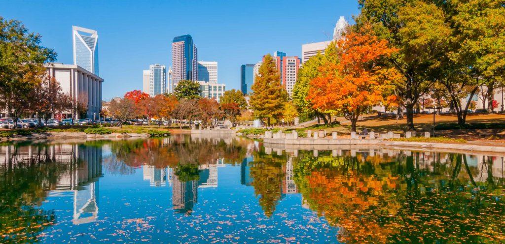 Charlotte city over lake in a park landscape