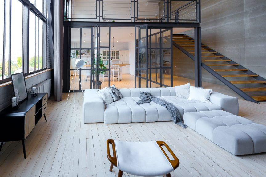 a luxury living room with a white sofa and clean interior