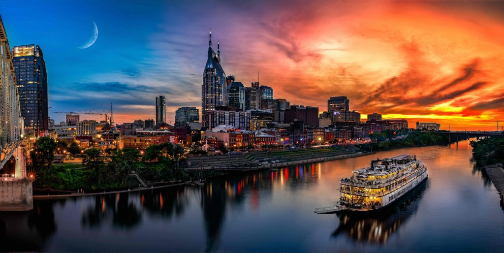 Nashville city skyline by the river and cruise on the water