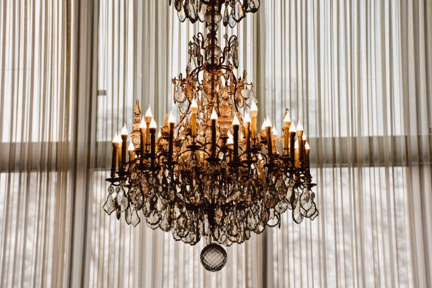A chandelier hanging in a luxury home