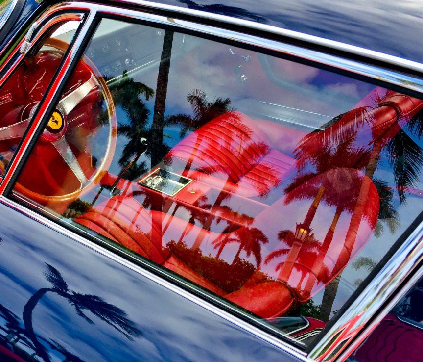 The interior of a luxury car seen through the car's window
