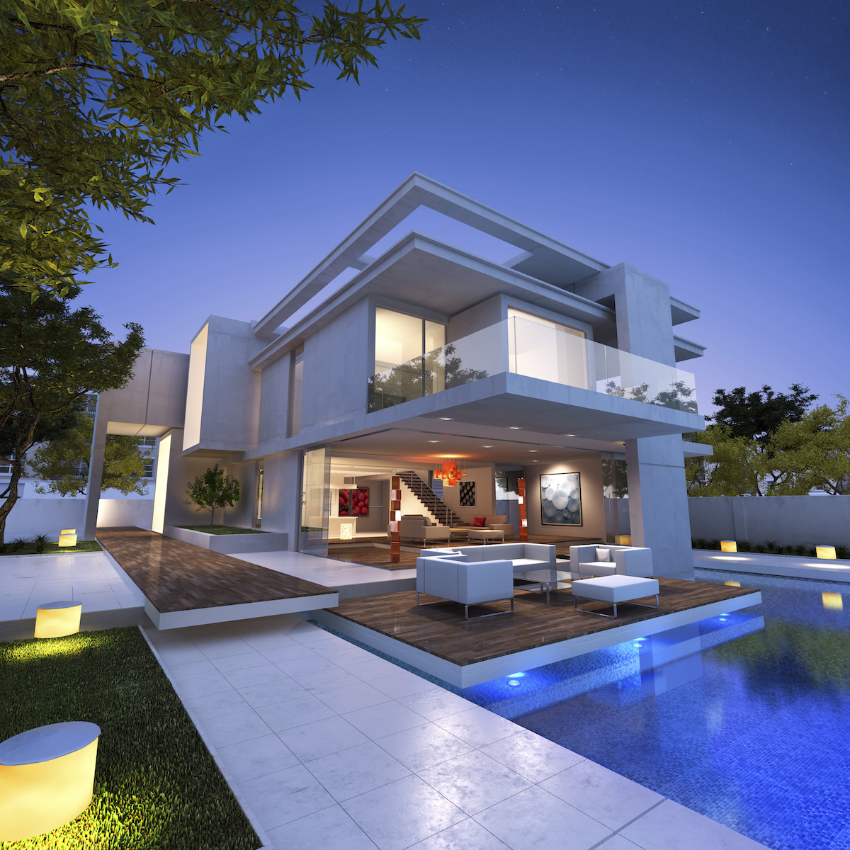 Exterior view of a contemporary luxury real estate property with pool at dusk