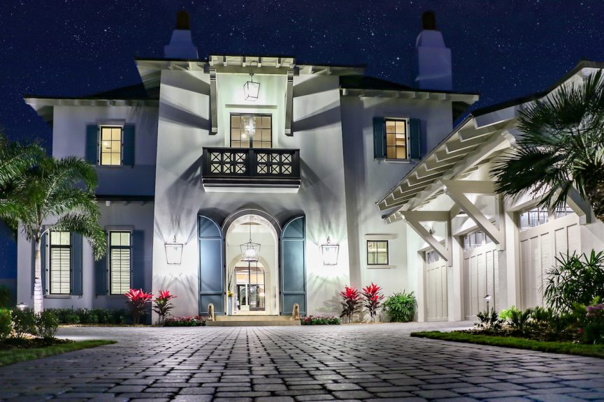 The exterior of a luxury home at night