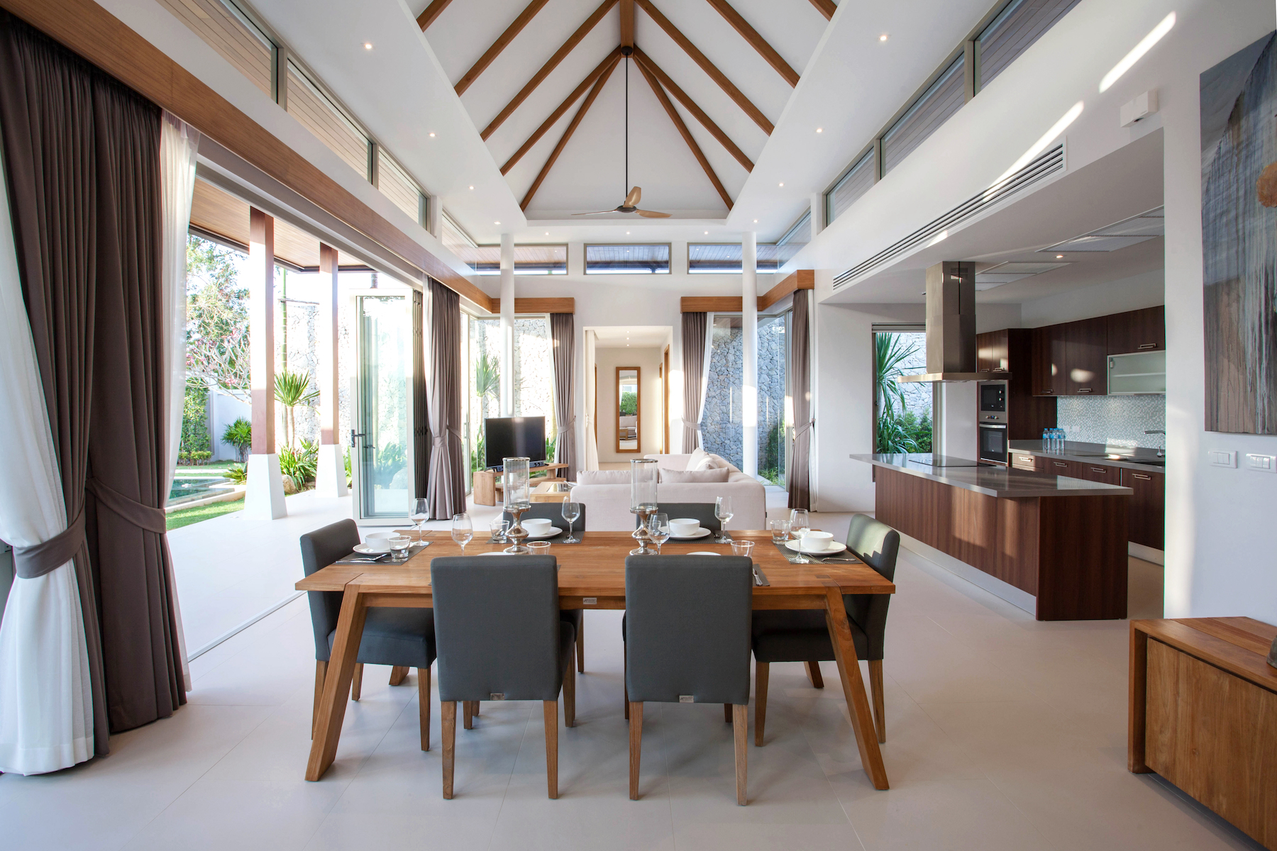 Luxury interior design in living room of pool villas. Airy and bright space with high raised ceiling and wooden dining table home, house , building , hotel, resort