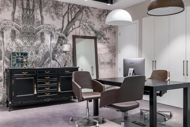 Gray and black luxury office with a desk and chairs.