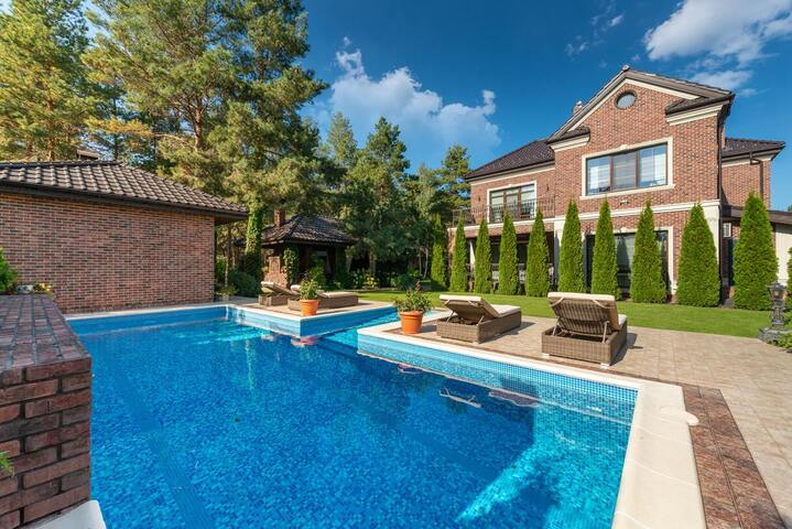 Outdoor pool in front of a historic brick building