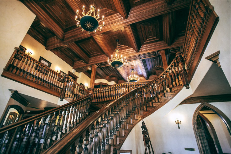 luxury home with a tall staircase